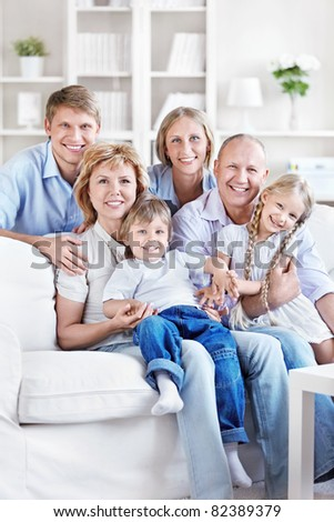 Happy family with children and grandchildren at home