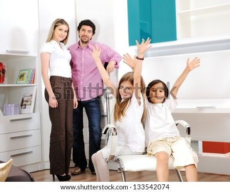 Happy family with children at home - stock photo