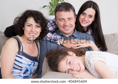 Happy family with 2 children at home , teenagers - stock photo