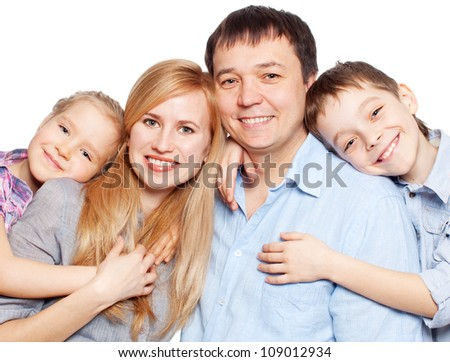 Happy family with children isolated on white background. Parents with daughter and son studio shot - stock photo