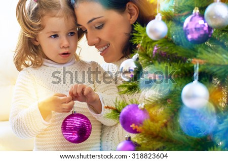 happy family with christmas gift - stock photo