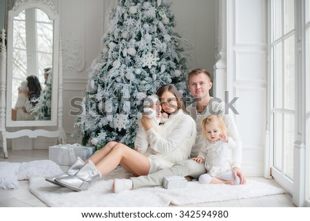 Happy family with Christmas gift. Xmas holiday concept - stock photo