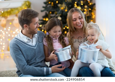 Happy family with gift - stock photo