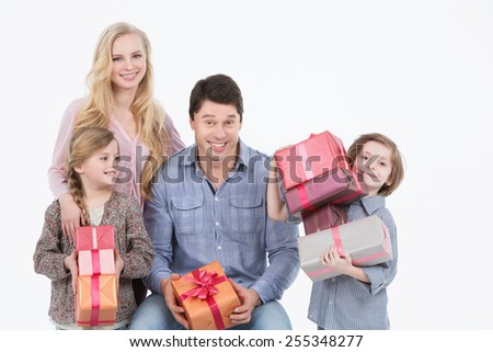 Happy family with gifts on a white background
