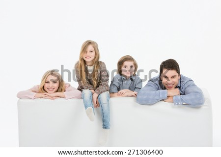 Happy family with kids on the couch white background