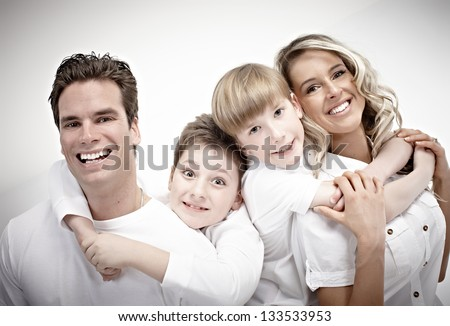 Happy family with kids. Over gray background.