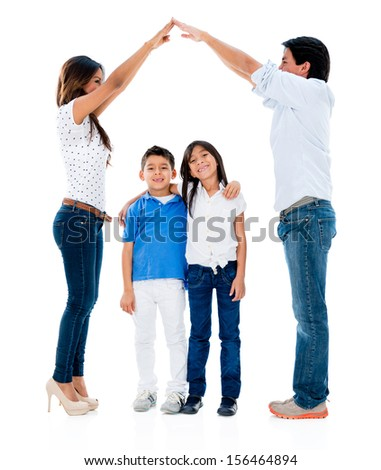 Happy family with kids under a safe roof  - isolated over white background  - stock photo