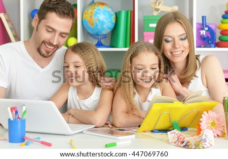 happy family with laptop - stock photo