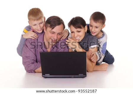 happy family with laptop on white