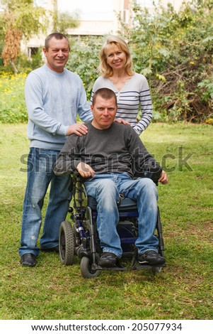 Happy family with Physical Impairment - stock photo