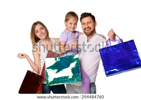 Happy family with shopping bags standing at studio, isolated on white background - stock photo