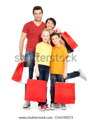 Happy family with shopping bags standing at studio over white background