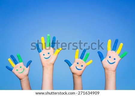 Happy family with smile on hands against blue summer sky background