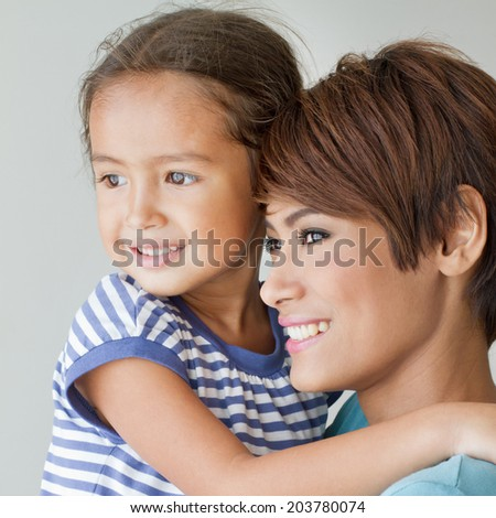 happy family with smiling, positive daughter and mother, square format - stock photo