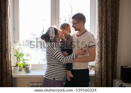 happy family with son kid toddler playing around  window, home real interior, lifestyle, toning, usual family,  evening light soft focus