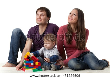Happy family with sweet baby build house on a white background.  Concept of  building and purchase  of the house. - stock photo