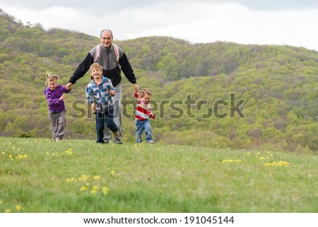 happy family with three kids enjoying free time on natural background - stock photo