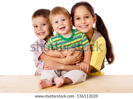 Happy family with three kids hugging together, isolated on white - stock photo