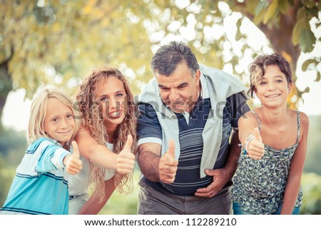 Happy Family with Thumbs Up - stock photo