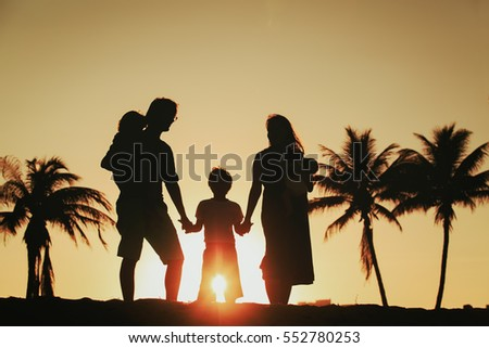 happy family with tree kids at sunset beach