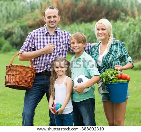 Happy family with two children spending summer day at the lawn