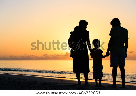 happy family with two kids at sunset