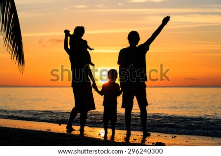 happy family with two kids having fun on sunset tropical beach