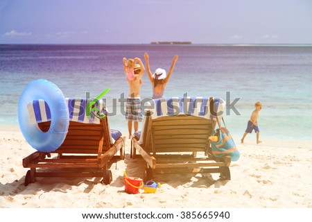 happy family with two kids on beach vacation - stock photo
