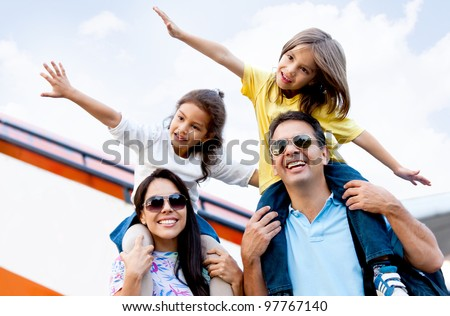 Happy family wth two kids traveling by airplane - stock photo