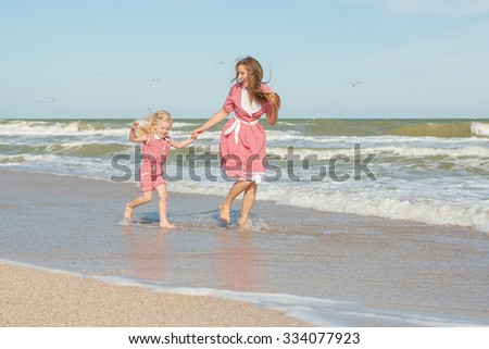 Happy family. Young beautiful  mother and her daughter  having fun on the beach. Positive human emotions, feelings.