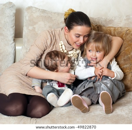 Happy family - Young beautiful mother with her little daughter and son - stock photo
