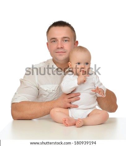 Happy family young father and child baby girl hugging on white background - stock photo
