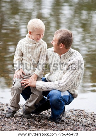 happy  family; young father and his five year old son near the lake outdoor on a summer day - stock photo