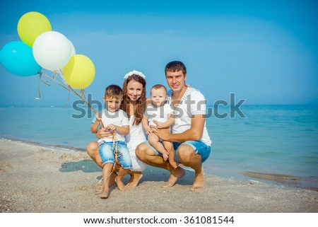 Happy family. Young happy beautiful  parents and their children having fun on the beach. Positive human emotions, feelings.