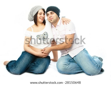 happy family, young man touching the belly of his pregnant wife - stock photo