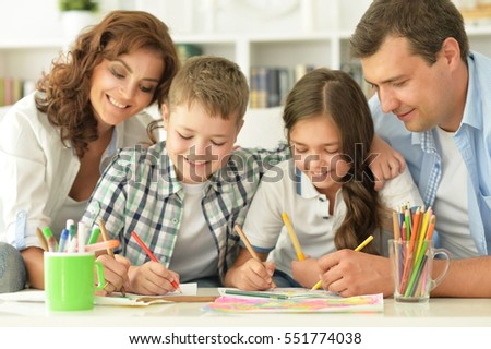 Of four coloring together at home happy family painting together