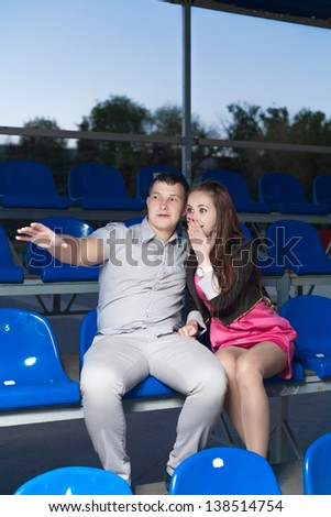Happy fans couple watching their favorite sport team. - stock photo