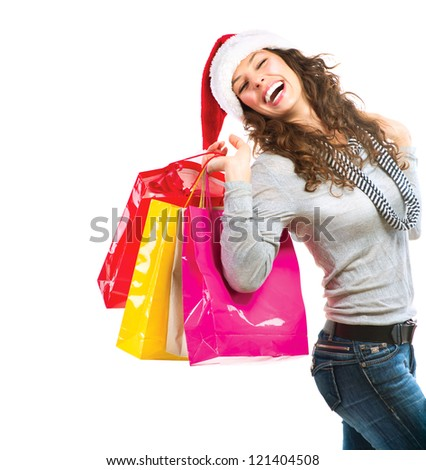 Happy Fashion Woman with Shopping Bags. Sales. Christmas Gifts. Christmas Shopping Girl Isolated on White Background. Christmas Gift. - stock photo