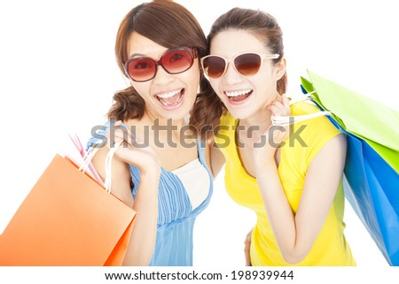 happy fashion young sisters with shopping bags - stock photo
