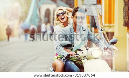 Happy fashionable couple in the city - stock photo