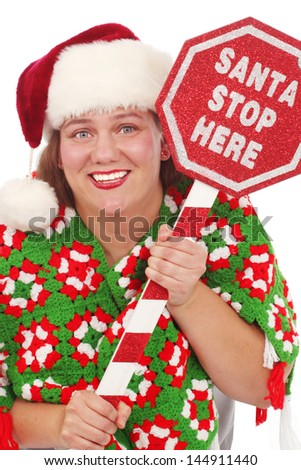 """Happy fat woman with a sign that states """"Santa Stop Here"""" - stock photo"""