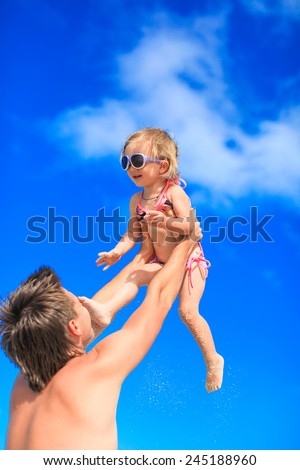 Happy father and adorable little daughter at tropical beach - stock photo