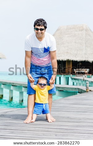 Happy Father and baby boy with sunglasses having tropical vacation on Maldives - stock photo