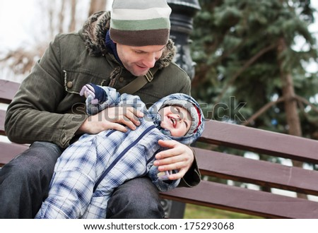 happy father and baby son playing outdoors - stock photo