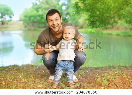 Happy father and child in the summer park - stock photo