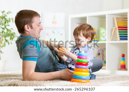 happy father and child son playing together indoor at home