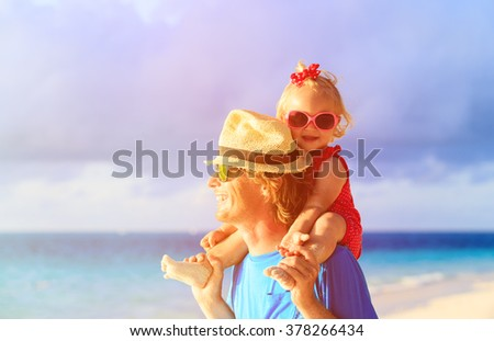 Happy father and cute little daughter at beach - stock photo