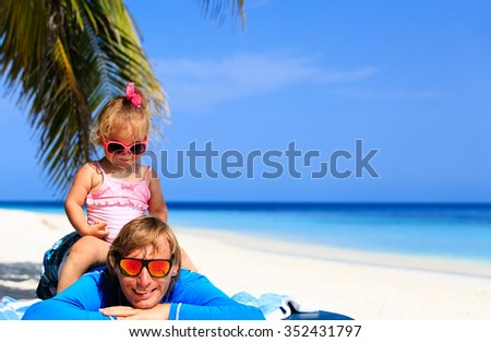 Happy father and cute little daughter at tropical beach