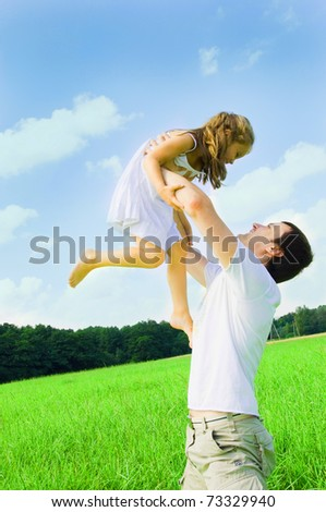 happy father and daughter against sky - stock photo