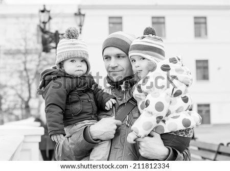 happy father and daughter and son for a walk  ( black and white ) - stock photo